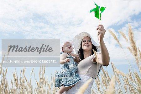 Woman holding pinwheel for daughter