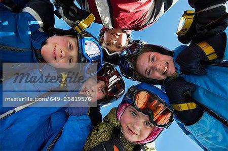 Children in ski gear standing together