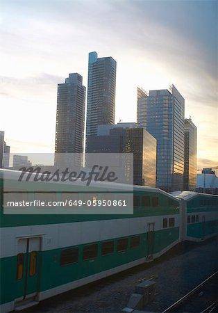 Train passing by Toronto city skyline