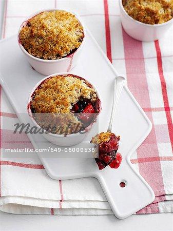 Bowls of fruit crisp on platter