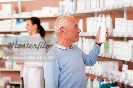 Customer browsing on drugstore shelves