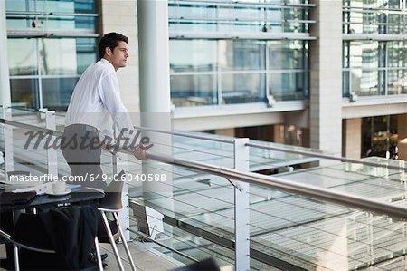 Businessman on indoor balcony