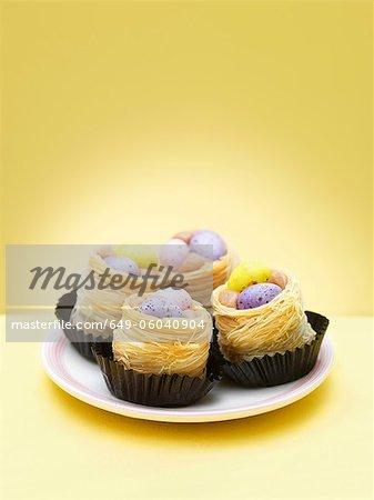 Chocolate eggs in decorative nests