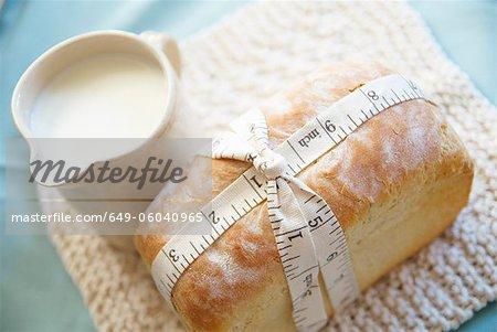 Measuring tape on fresh baked bread