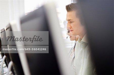 Businessman working in headset