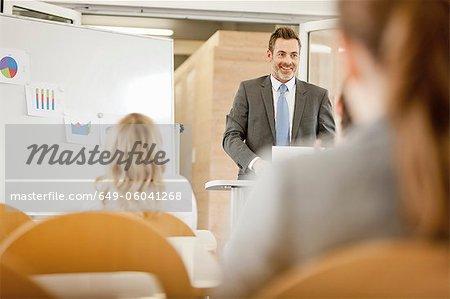 Businessman hosting seminar in office