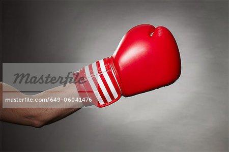 Hand wearing boxing glove