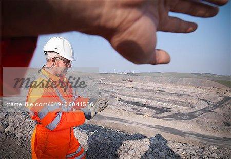 Workers walking in coal mine
