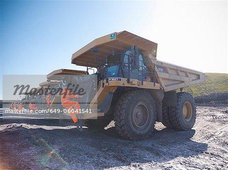 Workers climbing trucks at coal mine