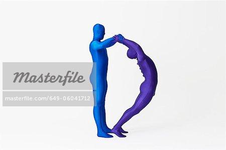 Men in bodysuits making the letter D