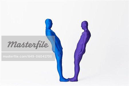 Men in bodysuits making the letter V