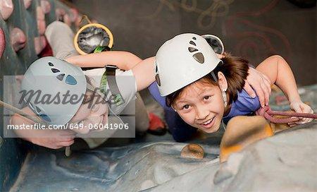 Girls climbing indoor rock wall