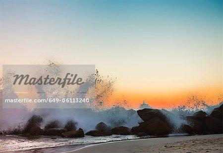 Waves crashing on Venice beach at sunset, Los Angeles, USA