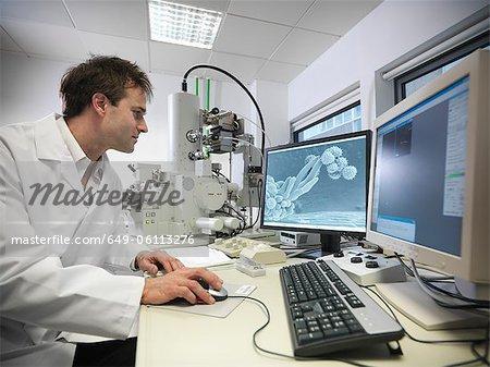 Scientist working on computer in lab