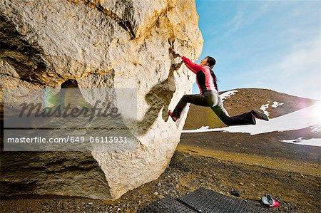 Woman bouldering in Josepsdalur, Iceland