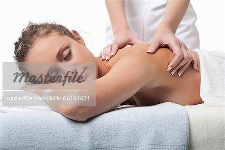 Smiling woman having back massage