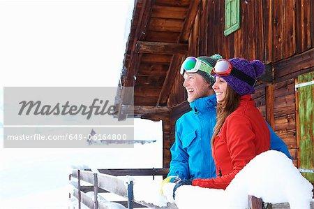 Couple overlooking snowy landscape