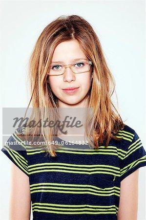 abff1dc5cf21 Smiling girl wearing glasses - Stock Photo - Masterfile - Premium ...