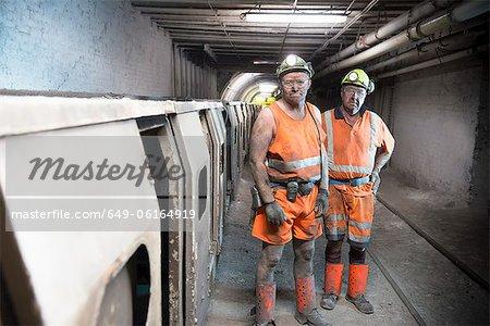 Coal miners standing in mine