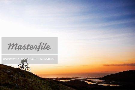 Mountain biker riding down hillside