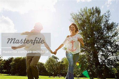Smiling women running outdoors