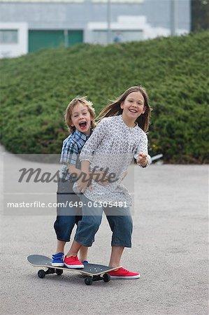 Children playing on skateboard