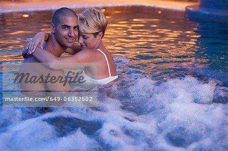 Couple relaxing in indoor jacuzzi