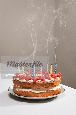 Smoking candles on birthday cake