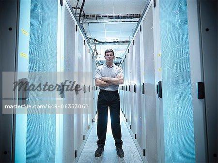 Worker standing in server room