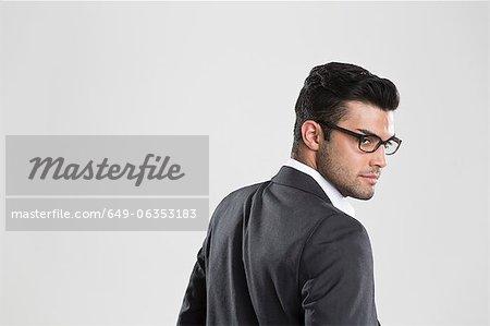 Businessman looking over his shoulder