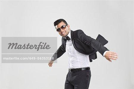 Smiling man in tuxedo dancing