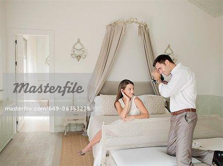 Woman having picture taken in bedroom