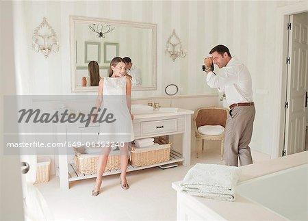 Woman having picture taken in bathroom