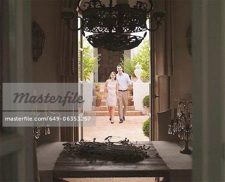 Couple walking in courtyard