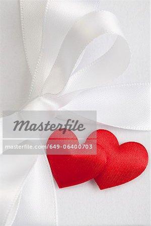 Satin hearts on gift box