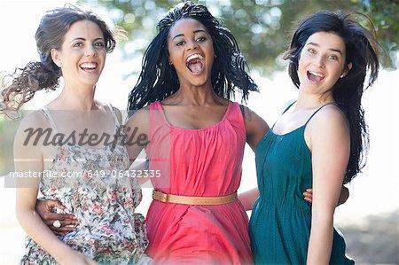 Smiling women hugging outdoors