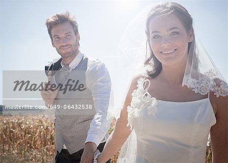 Newlywed couple walking outdoors