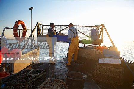 Fishermen at work on boat