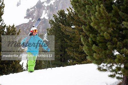 Skier climbing snowy slope