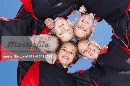 Girls smiling in circle