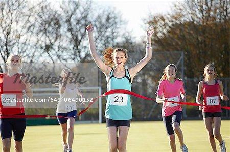 Runner crossing finish line in field