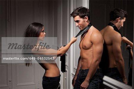 Woman grabbing boyfriend by tie