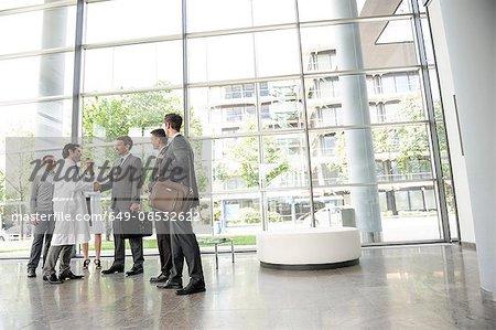 Doctors and businessmen meeting