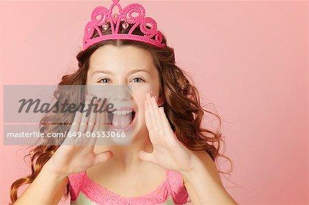 Shouting girl wearing pink tiara