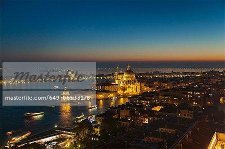 Coastal city lit up at night
