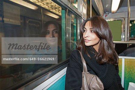 Smiling woman riding subway