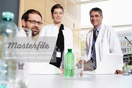 Doctors smiling at desk