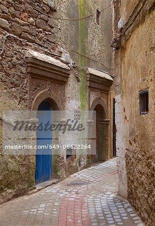 Arched doors in village alleyway
