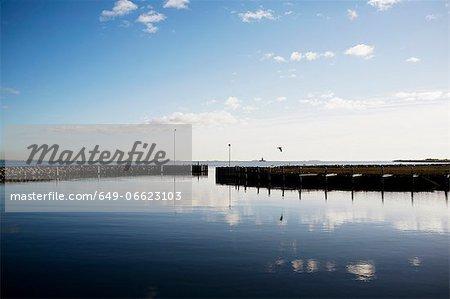 Sky reflected in still harbor