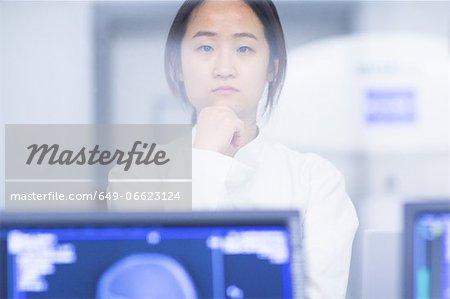 Doctor standing in CT scanner room